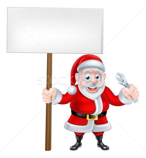 Cartoon Santa Holding Sign and Wrench Stock photo © Krisdog