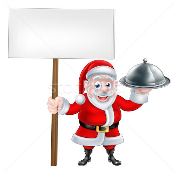 Santa Holding Dinner and Sign Stock photo © Krisdog