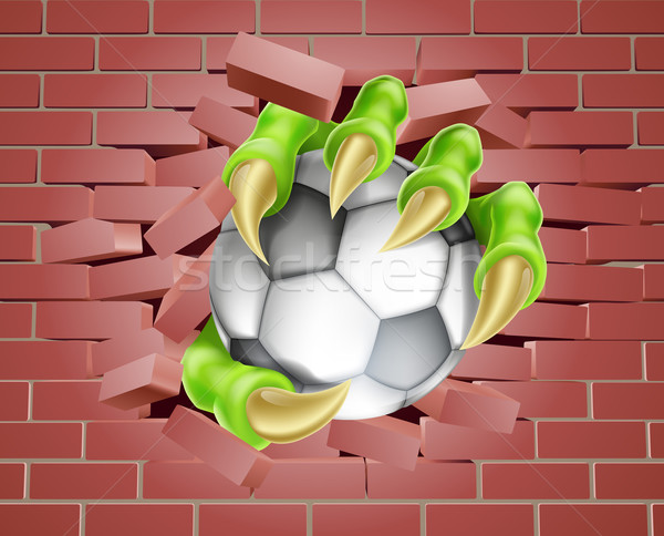 Claw with Soccer Ball Breaking Through Brick Wall Stock photo © Krisdog