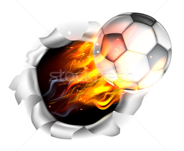 Stock photo: Flaming Soccer Football Ball Tearing a Hole in the Background