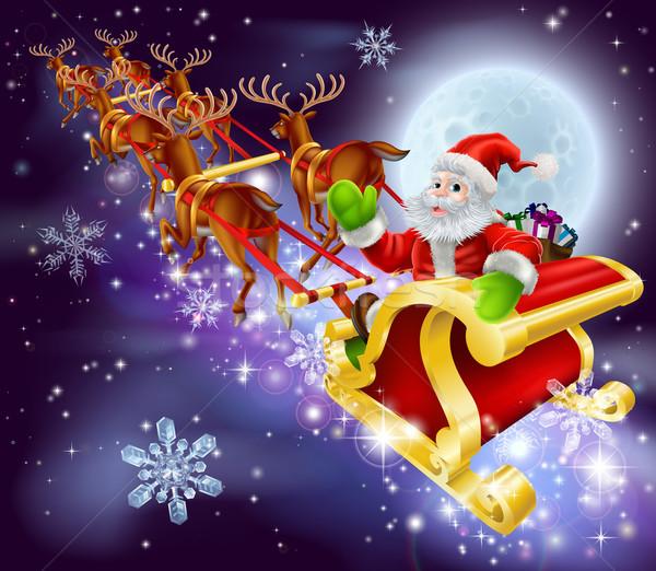 Christmas Santa flying in his sled or sleigh Stock photo © Krisdog