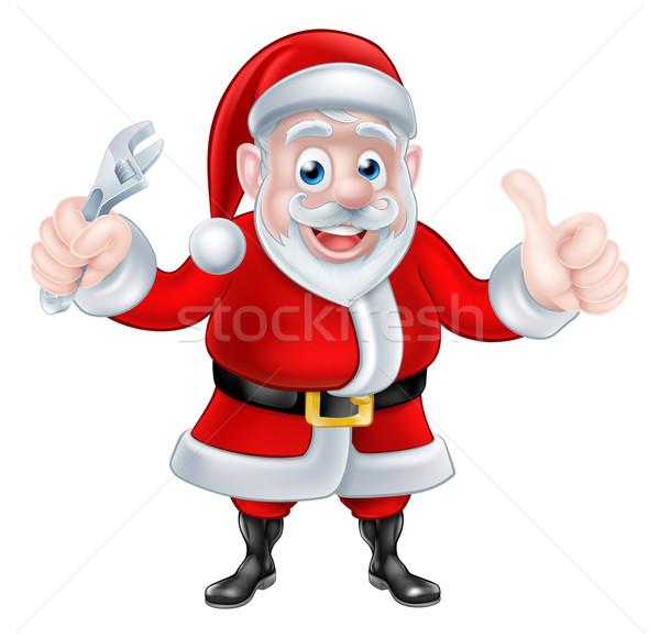 Cartoon Santa Thumbs Up and Holding Wrench Spanner Stock photo © Krisdog