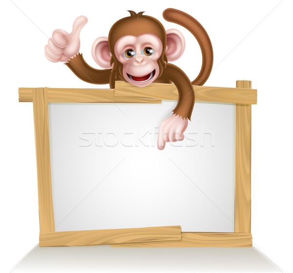 Cartoon małpa podpisania charakter wskazując strony Zdjęcia stock © Krisdog