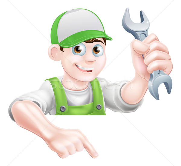 Man Holding Spanner and Pointing Stock photo © Krisdog