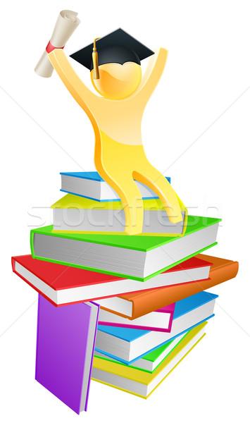 Graduate gold person and books  Stock photo © Krisdog
