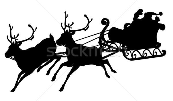 Święty mikołaj sanie sylwetka Święty mikołaj renifer Zdjęcia stock © Krisdog