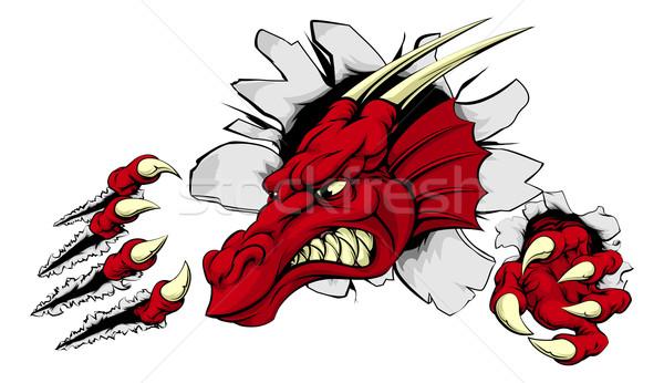Red dragon mascot breaking through wall Stock photo © Krisdog