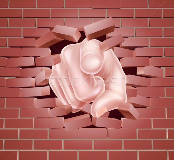 Pointing Hand Breaking Red Brick Wall Stock photo © Krisdog