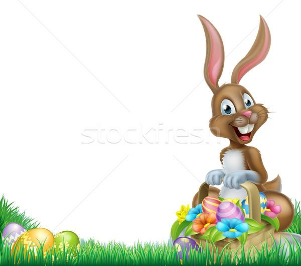 Rajz húsvéti nyuszi kosárnyi tojás kosár csokoládé húsvéti tojások Stock fotó © Krisdog