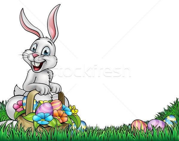 Húsvét rajz húsvéti nyuszi tart kosár tele Stock fotó © Krisdog