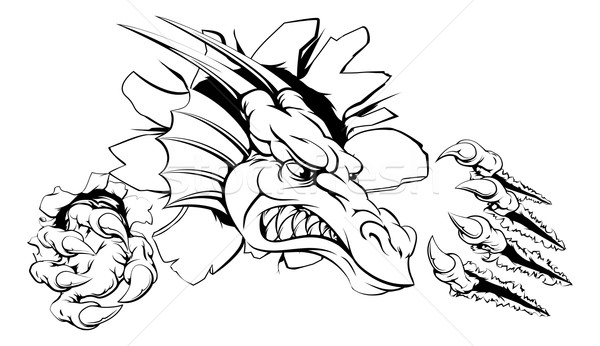 Stock photo: Dragon ripping through wall