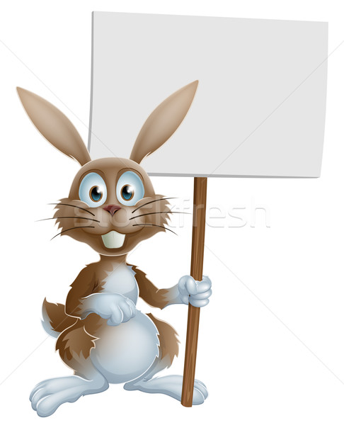 Easter bunny holding sign Stock photo © Krisdog