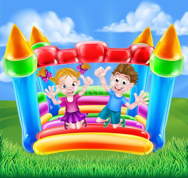 Cartoon Kids on Bouncy Castle Stock photo © Krisdog