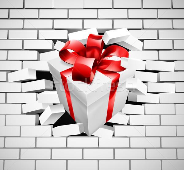 Gift Present Smashing Through Wall Stock photo © Krisdog