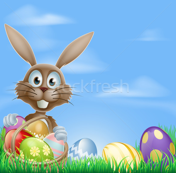 Easter bunny and chocolate eggs Stock photo © Krisdog