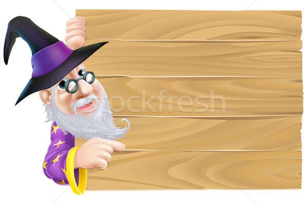 Wizard pointing at wood sign Stock photo © Krisdog
