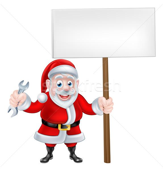 Cartoon Santa Holding Spanner and Sign Stock photo © Krisdog
