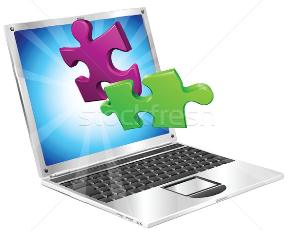 Jigsaw puzzle pieces flying out of laptop computer Stock photo © Krisdog