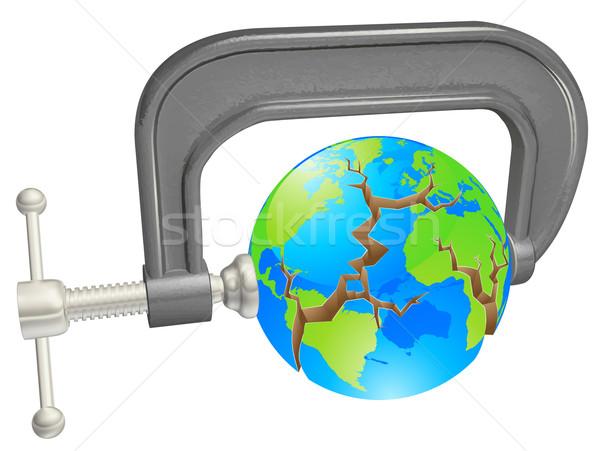 Clamp breaking world globe Stock photo © Krisdog