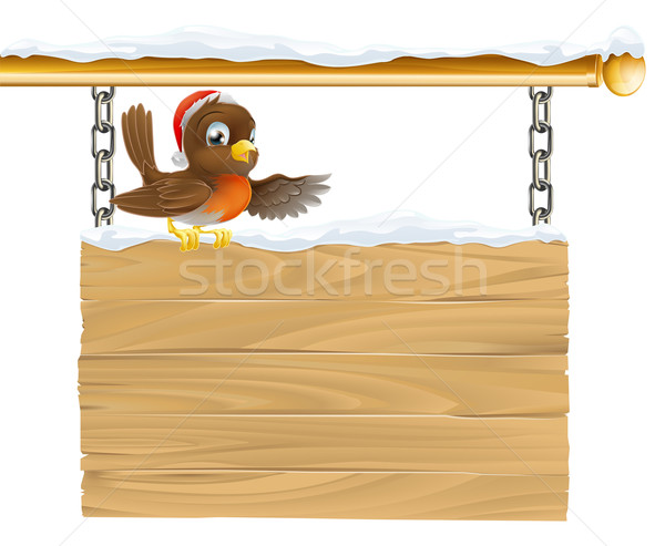 Stock photo: Christmas Santa hat bird on sign