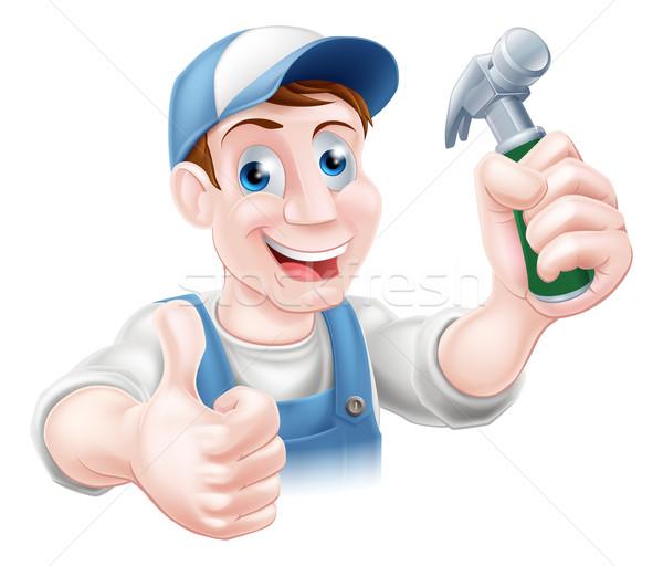 Handy man holding hammer Stock photo © Krisdog