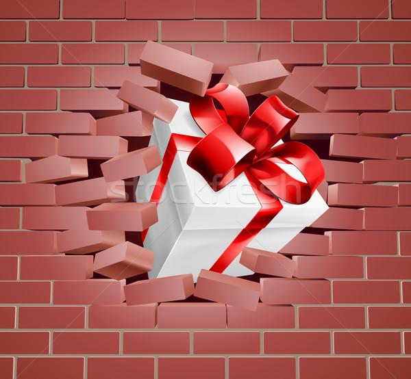 Gift Present Breaking Through Wall Stock photo © Krisdog