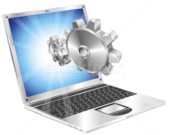 Gear cogs flying out of laptop screen concept Stock photo © Krisdog