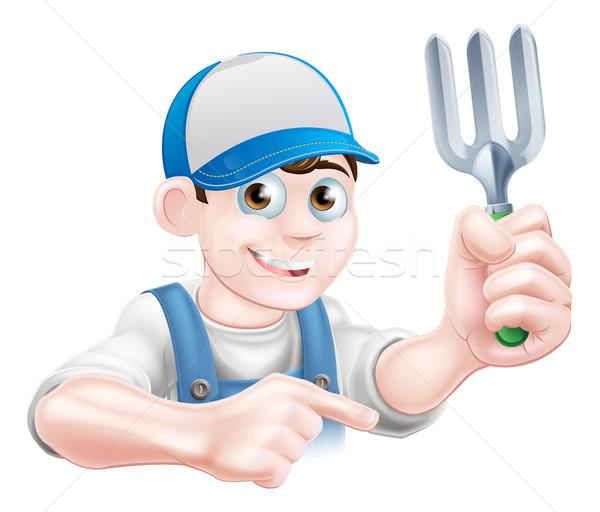 Cartoon Gardener Holding Fork Stock photo © Krisdog