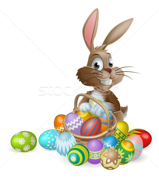 Stock photo: Easter bunny rabbit with Easter eggs basket