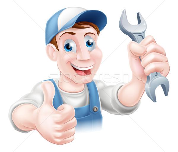 Mechanic holding spanner Stock photo © Krisdog