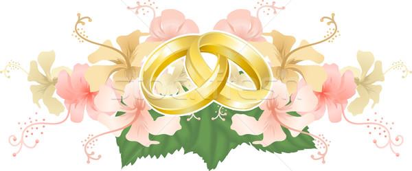 Wedding designg intertwined wedding rings and hibiscus Stock photo © Krisdog