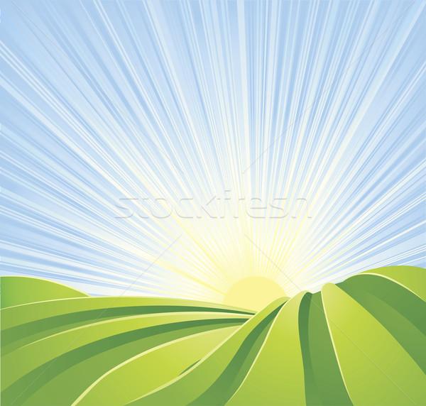 Stockfoto: Idyllisch · groene · velden · zonneschijn · stralen · blauwe · hemel