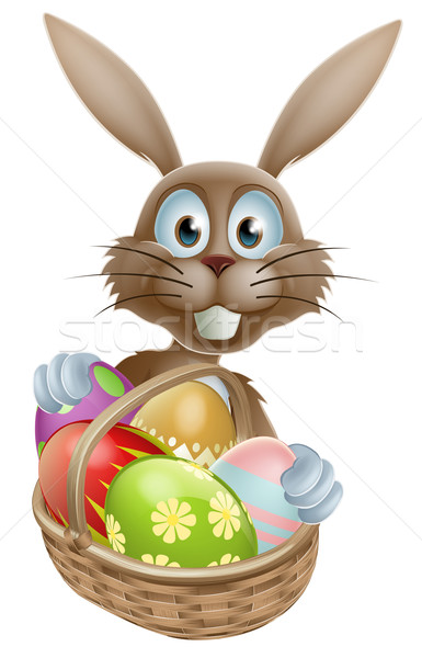 Easter bunny with eggs basket Stock photo © Krisdog