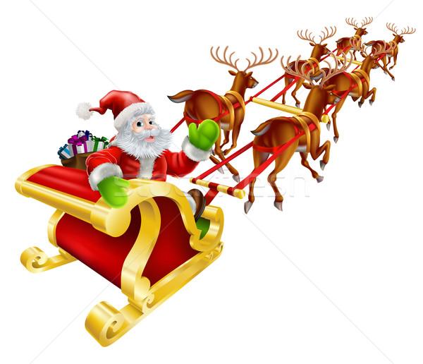 Christmas Santa Claus flying in sleigh  Stock photo © Krisdog