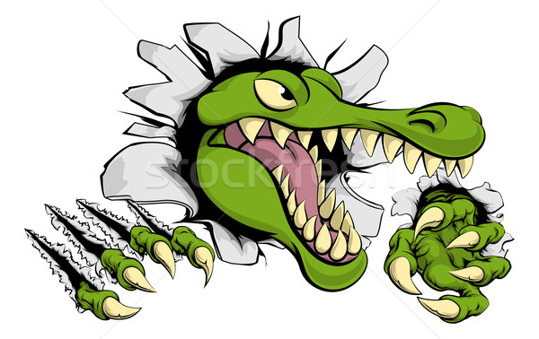 Alligator or crocodile smashing through wall Stock photo © Krisdog