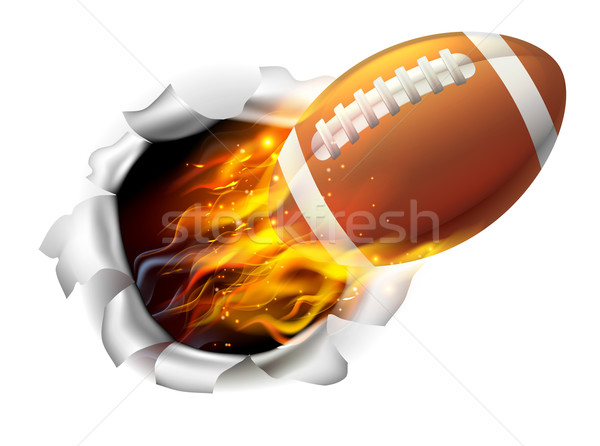 Flaming American Football Ball Tearing a Hole in the Background Stock photo © Krisdog