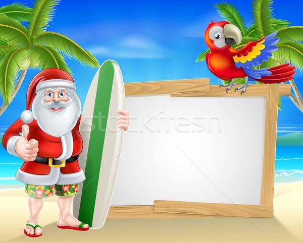Surfowania pokładzie Święty mikołaj tropikalnej plaży podpisania cartoon Zdjęcia stock © Krisdog