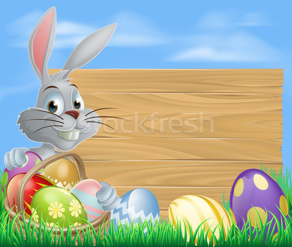 Rabbit with eggs basket and Easter sign Stock photo © Krisdog