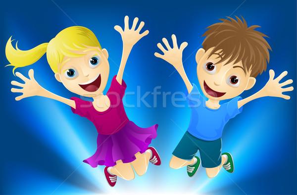 Happy children jumping for joy Stock photo © Krisdog