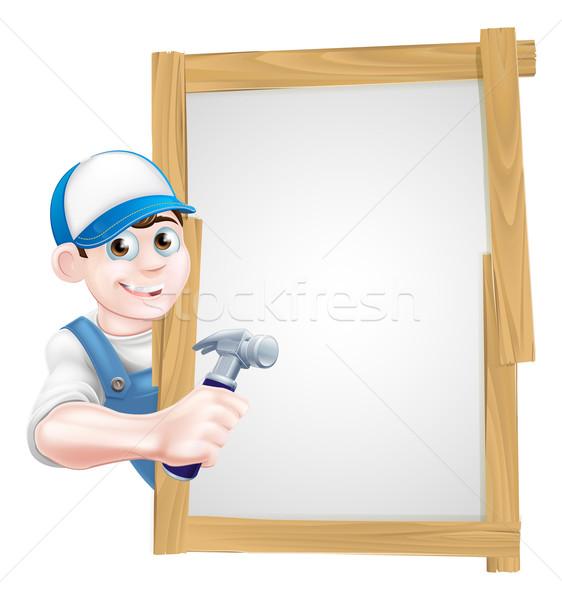 Carpenter Holding Hammer Sign Stock photo © Krisdog