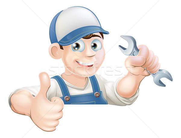 Spanner man over sign thumbs up Stock photo © Krisdog