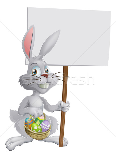 Easter bunny with eggs and sign Stock photo © Krisdog