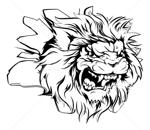Lion head breaking through background Stock photo © Krisdog