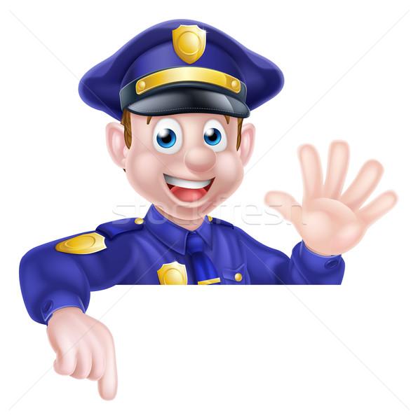 Cartoon policjant wskazując przyjazny podpisania Zdjęcia stock © Krisdog
