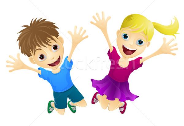 Happy children jumping in the air Stock photo © Krisdog