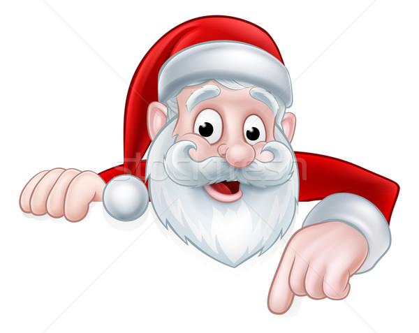 Peeking Cartoon Santa Pointing Down Stock photo © Krisdog