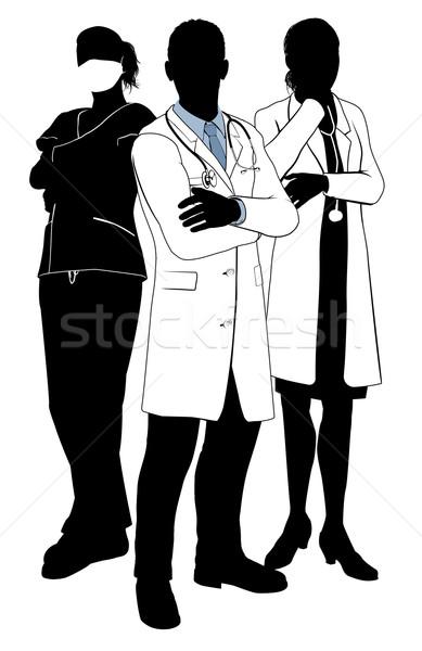 Medical team doctor silhouettes Stock photo © Krisdog