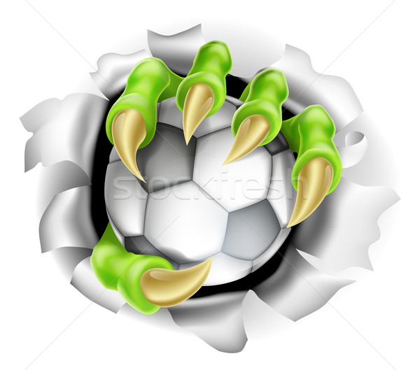 Claw with Soccer Ball Breaking out Of Background Stock photo © Krisdog