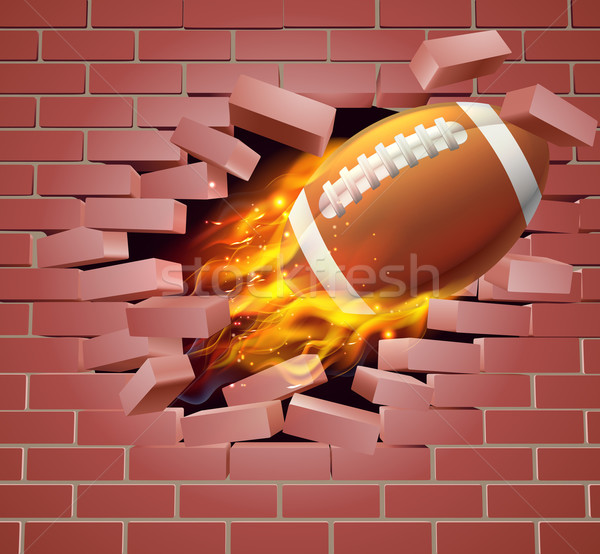 Flaming American Football Ball Breaking Through Brick Wall Stock photo © Krisdog