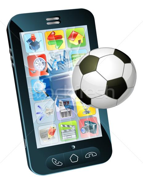 футбольным мячом Flying из сотового телефона иллюстрация экране Сток-фото © Krisdog